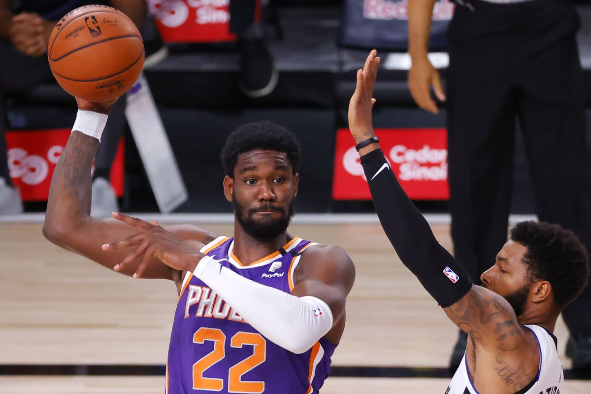 Marcus Morris Sr. #31 of the LA Clippers defends Deandre Ayton #22 of the Phoenix Suns at The Arena at ESPN Wide World Of Sports Complex on August 04, 2020 in Lake Buena Vista, Florida.