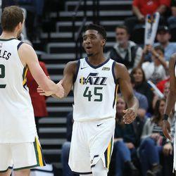 Utah Jazz forward Joe Ingles (2) Utah Jazz guard Donovan Mitchell (45) and Utah Jazz guard Rodney Hood (5) talk as a timeout is called as the Utah Jazz and the Brooklyn Nets play at Vivint arena in Salt Lake City on Saturday, Nov. 11, 2017.