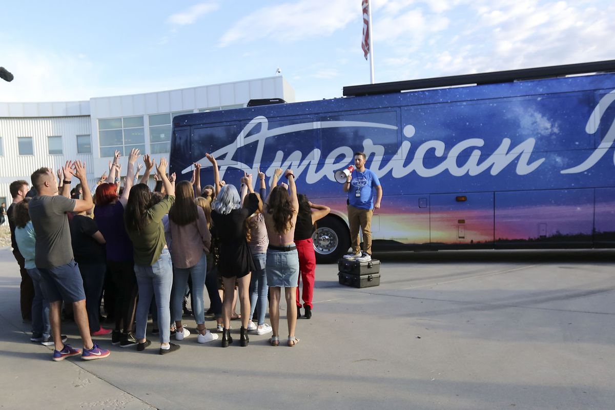 """Collin DeClerk, production assistant, tries to get the crowd excited while filming before """"American Idol"""" auditions outside of the Northwest Community Center in Salt Lake City on Thursday, Aug. 29, 2019."""