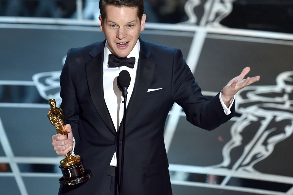Graham Moore receives the award for Best Adapted Screenplay at the 87th Oscars.
