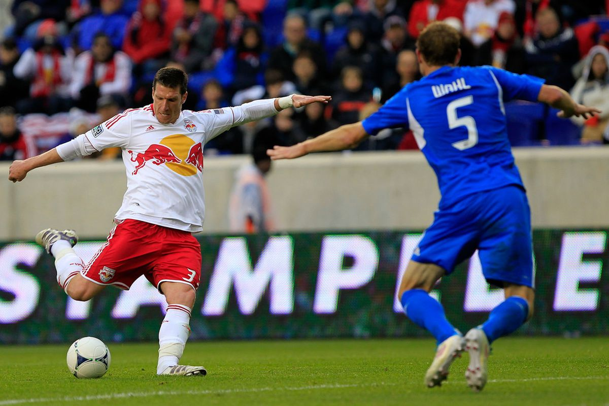 HARRISON, NJ - MARCH 31:  Kenny Cooper #33 of the New York Red Bulls is challenged by Tyson Wahl #5 of the Montreal Impact at Red Bull Arena on March 31, 2012 in Harrison, New Jersey.  (Photo by Chris Trotman/Getty Images)