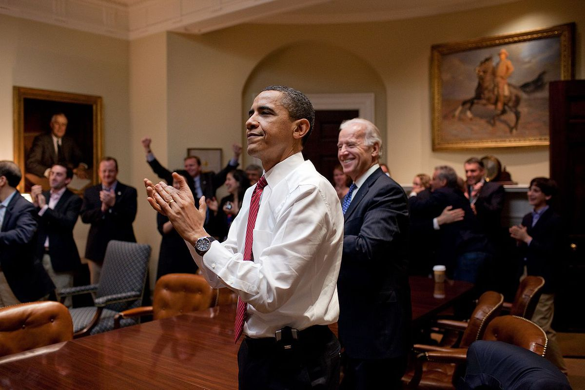 Obama claps when he find out his universally beloved health care reform solution has become law, March 2010.