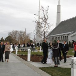 Members greet each other prior to Sunday's rededication of the Boise Idaho Temple.