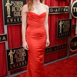 Jessica Chastain in bright-red, strapless McQueen.