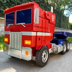 Optimus Prime in truck mode, with nice bright LED headlights and folding side mirrors.
