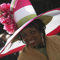 Harriet Rosebud smiles as she poses for photographers during the Easter Parade on Fifth Ave.,  Sunday, April 8, 2012 in New York.