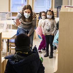 Preschool teacher Erin Berry greets students as they walk into Dawes Elementary School at 3810 W. 81st Pl. on the Southwest Side, Monday morning, Jan. 11, 2021.