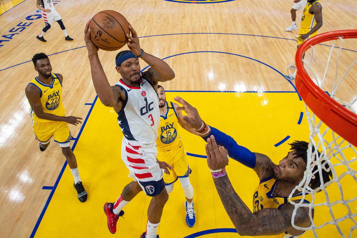 Washington Wizards guard Bradley Beal shoots the basketball against Golden State Warriors forward Marquese Chriss during the second half at Chase Center.
