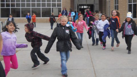 Children coming to the playground for recess at Thimmig Elementary.