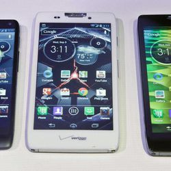 Motorola's three new Droid Razr smartphones, the Droid Razr M, center, the Droid Razr HD, center, and the Droid Razr Maxx HD, are unveiled at a press conference on Wednesday, Sept. 5, 2012.  The phones are the first from Motorola as a part of Google.