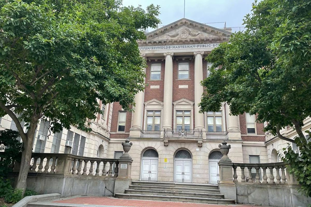 An exterior shot of Julia R. Masterman High School on Spring Garden Street, with trees in the foreground.