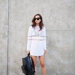 """Rumi of <a href=""""http://fashiontoast.com""""target=""""_blank"""">Fashion Toast</a> is wearing an Alexander Wang x H&M knit dress and backpack and Saint Laurent sandals."""