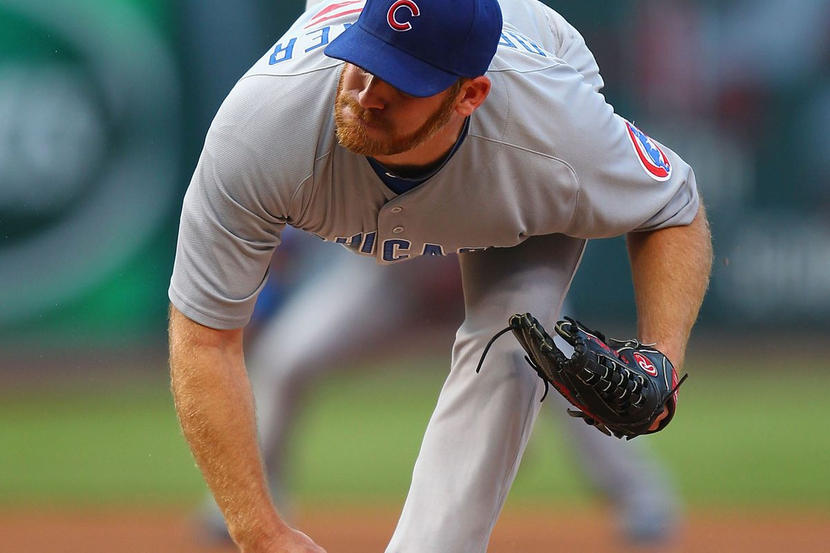 Starter Ryan Dempster of the Chicago Cubs pitches against the St. Louis Cardinals at Busch Stadium in St. Louis, Missouri.  (Photo by Dilip Vishwanat/Getty Images)