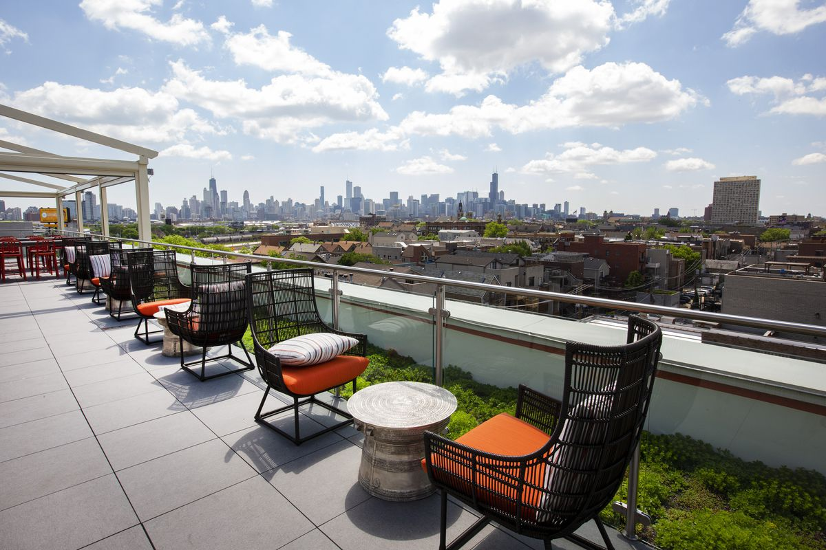 A large rooftop patio space overlooking the Chicago skyline.