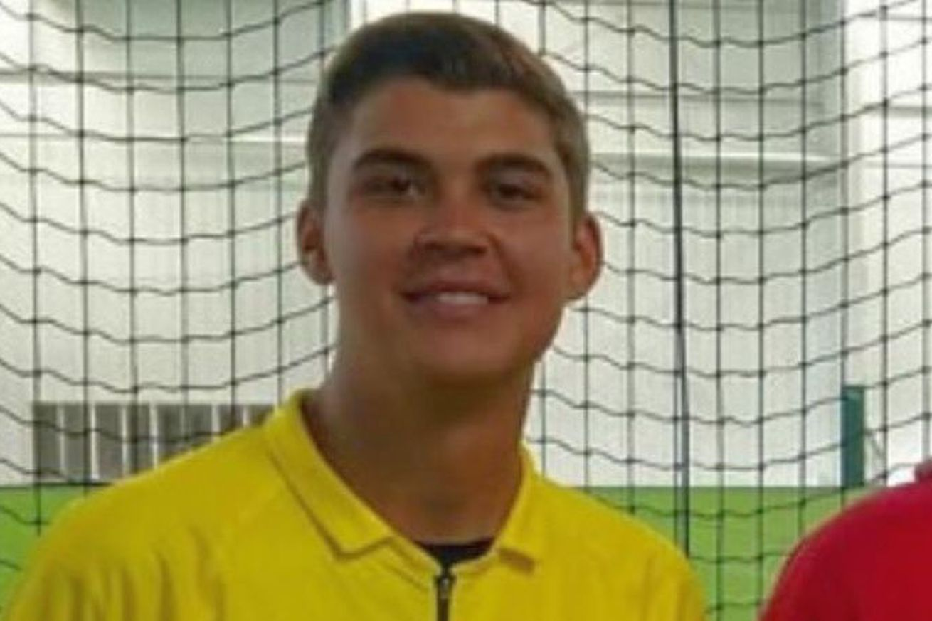 Alec Pena in a referee shirt.