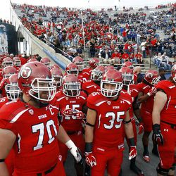 Utah Players stack up before running out on the field to get warmed up prior to the game as they prepare to play Utah Saturday, Sept. 17, 2011 at Lavell Edwards Stadium.