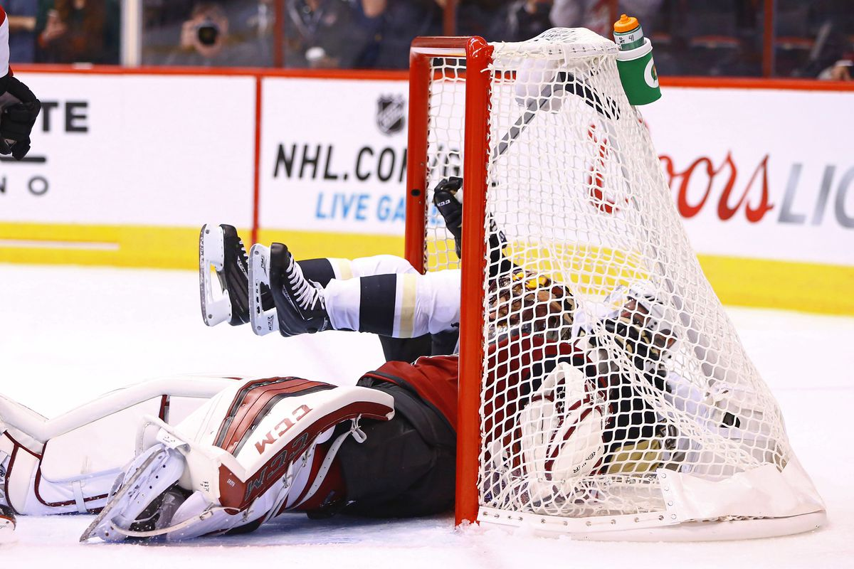 After a frenetic opening weekend, Mike Smith and Sidney Crosby settle down for a nap.