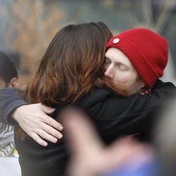 Summer Osburn hugs Chris Manor after speaking about James Barker's death. Utah Against Police Brutality held a protest outside the Salt Lake City Public Safety Building in Salt Lake City Saturday, Jan. 10, 2015.