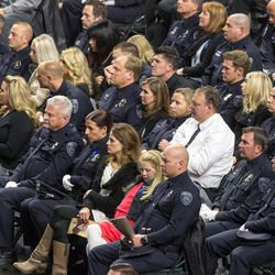 Law enforcement officers listen during funeral services for Unified police officer Doug Barney at the Maverik Center in West Valley City on Monday, Jan. 25, 2016.