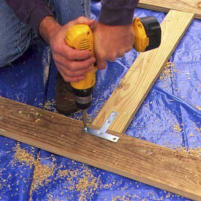 Man Connects Center Stile Of New Deck Lattice
