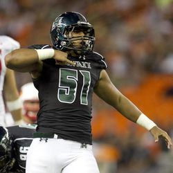 Hawaii linebacker Lance Williams reacts after the defense stopped a Lamar play during the third quarter of the NCAA game between the Lamar and Hawaii, Sept. 15, 2012 in Honolulu.