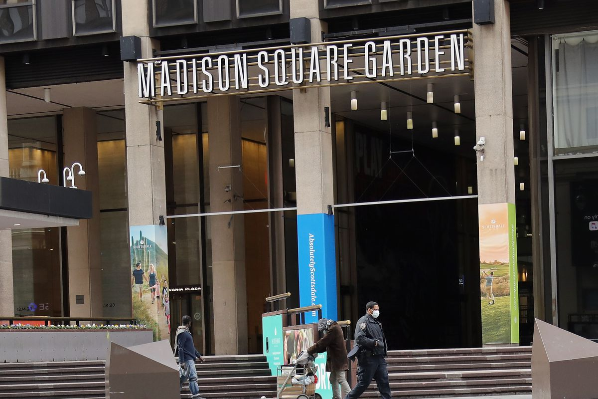 A masked police officer makes his way past Madison Square Garden on April 02, 2020 in New York City. Currently, over 92,000 people in New York state have tested positive for COVID-19.
