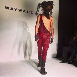 """For fall, Wayward envisions men wearing single-shoulder red leather overalls. <span class=""""credit"""">[Photo via @_waywardco_/<a href=""""http://instagram.com/p/lmG6cbrK1d/"""">Instagram</a>]</span>"""