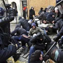 Croatian anti-riot police officers clash with protesters following in Zagreb, Croatia, Saturday, Feb. 26, 2011. Some 15,000 anti-government protesters rallied in the Croatian capital and some clashed with police.