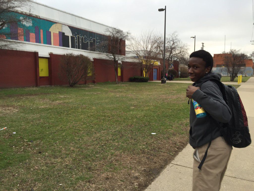 Myesha Williams' 14 year-old son, Edmond, one of three sons who goes to three different schools, heads to the Phoenix Multicultural Academy in Southwest Detroit. (Photo by: Erin Einhorn/Chalkbeat Detroit)