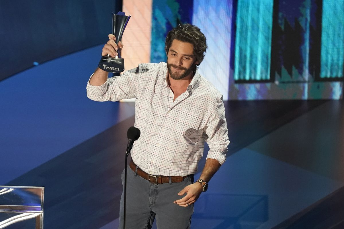 Thomas Rhett accepts the entertainer of the year award in a tie with Carrie Underwood during the 55th annual Academy of Country Music Awards at the Grand Ole Opry House on Wednesday, Sept. 16, 2020, in Nashville, Tenn.