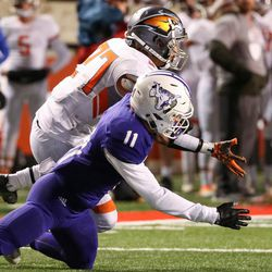 Skyridge's Eli Pulu breaks up a pass intended for Lehi's Kade Moore in the 5A football state championship game at Rice-Eccles Stadium in Salt Lake City on Friday, Nov. 17, 2017.