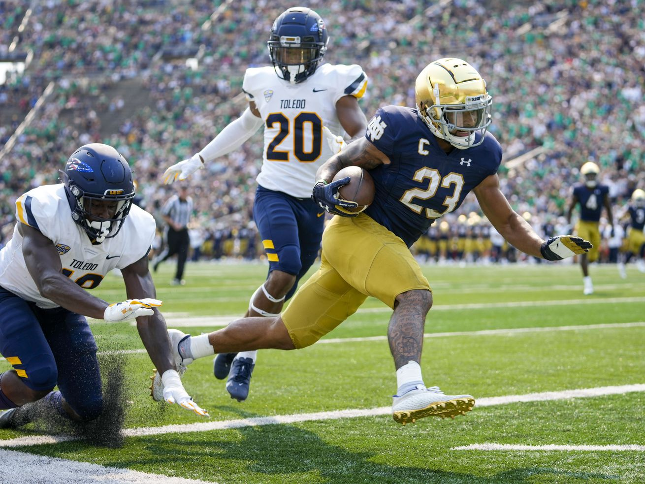 Notre Dame running back Kyren Williams (23) scores a touchdown in front of Toledo's Saeed Holt (20) and Nate Givhan (48) last Saturday.