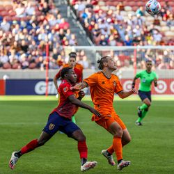 Real Salt Lake forward Anderson Julio, left, battles Houston Dynamo defender Sam Junqua for the ball as RSL and Houston play an MLS soccer game at Rio Tinto Stadium in Sandy on Saturday, June 26, 2021.
