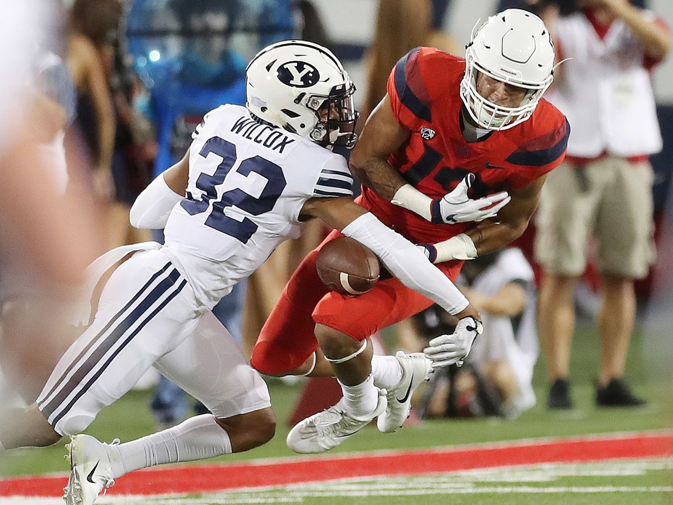 BYU defensive back Chris Wilcox defends Arizona wide receiver Shawn Poindexter (19) in Tucson, Arizona, on Saturday, Sept. 1, 2018. Wilcox has become a leader in the Cougars' secondary.