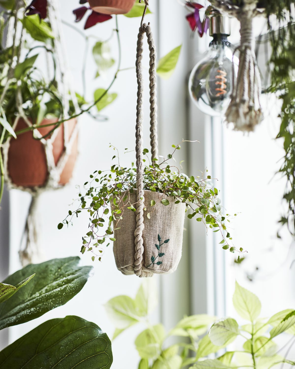 Woven basket hanging from hook.