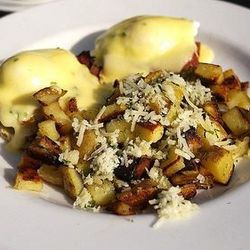 Eggs benedict at Axis Cafe by spectrograf