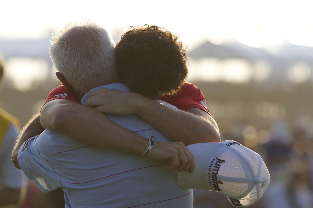 Aug 12, 2012; Kiawah Island, SC, USA;  Rory McIlroy (IRL) embraces his father Jerry McIlroy after winning the 94th PGA Championship at the Ocean Course of the Kiawah Island Golf Resort. Mandatory Credit: Joshua S. Kelly-US PRESSWIRE