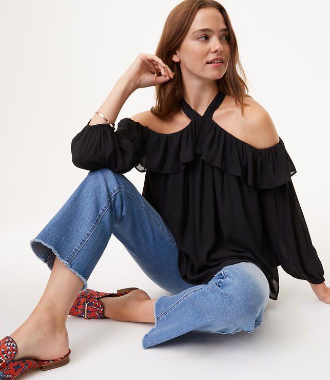model in black off shoulder blouse