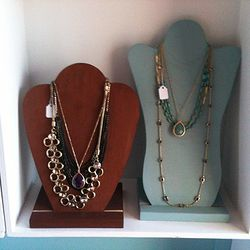 The necklace on the left is $38. The one on the right is $26.