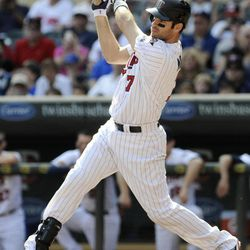 Minnesota Twins' Joe Mauer hits a single off Detroit Tigers pitcher Anibal Sanchez in the first inning of a baseball game Sunday, Sept. 30, 2012 in Minneapolis. Mauer, in a race for the American League batting title, went 3-for-4 and a walk in the Tigers' 2-1 win.