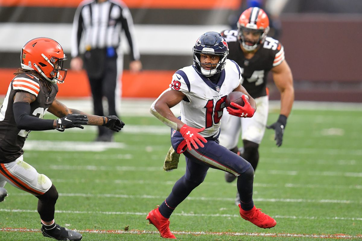 Cornerback Kevin Johnson #28 of the Cleveland Browns tries to tackle wide receiver Randall Cobb #18 of the Houston Texans during the second half at FirstEnergy Stadium on November 15, 2020 in Cleveland, Ohio.