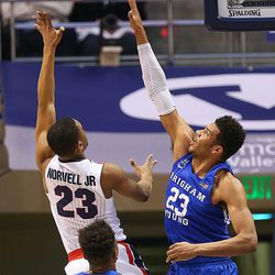 Gonzaga Bulldogs guard Zach Norvell Jr. (23) pushes a shot over Brigham Young Cougars forward Yoeli Childs (23) as BYU and Gonzaga play in an NCAA basketball game in the Marriott Center in Provo on Saturday, Feb. 24, 2018.