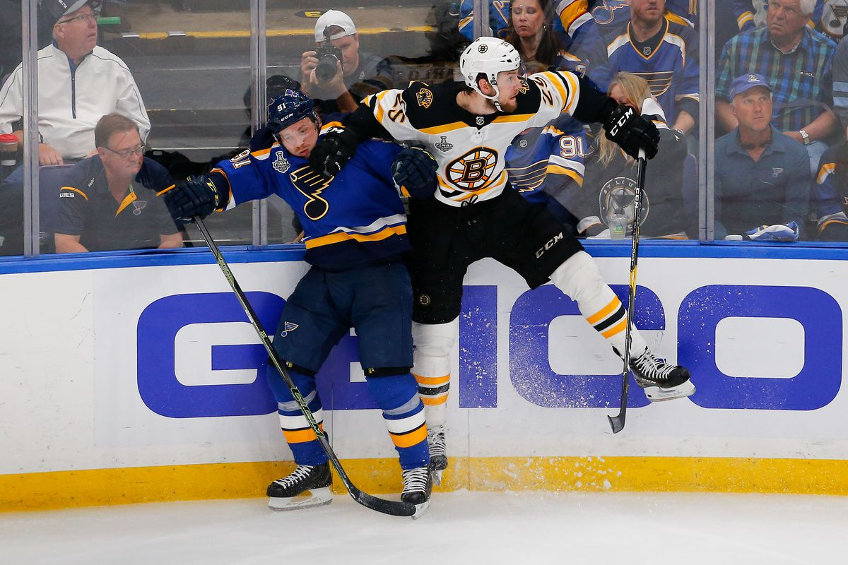 Jun 1, 2019; St. Louis, MO, USA; Boston Bruins defenseman Brandon Carlo (25) checks St. Louis Blues right wing Vladimir Tarasenko (91) into the boards during the third period in game three of the 2019 Stanley Cup Final at Enterprise Center. Mandatory Cred