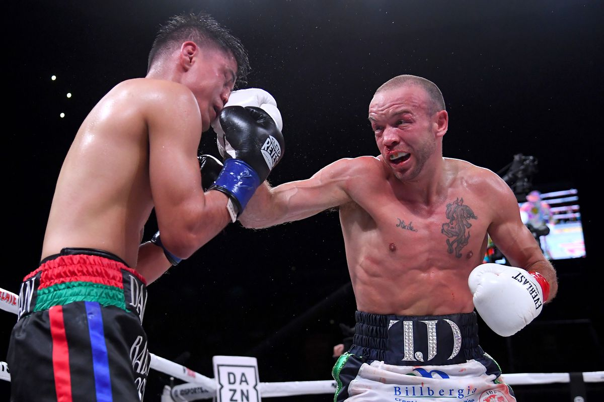 J Doheny (white shorts) and Daniel Roman (black shorts) exchange punches in their Super Bantamweight fight at The Forum on April 26, 2019 in Inglewood, California. Roman won by decision.