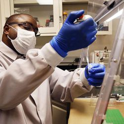 Christopher Sakala of Zambia trains in DNA extraction at Sorenson Forensics in Salt Lake City, Tuesday, Aug. 27, 2013.