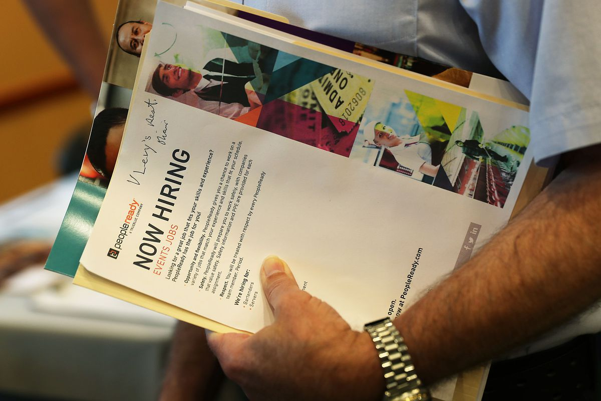 A person holds his paperwork as he attends a job fair put on by Miami-Dade County and other sponsors on April 05, 2019 in Miami, Florida. The job fair was being held as the Labor Department released its monthly hiring and unemployment figures for March wh