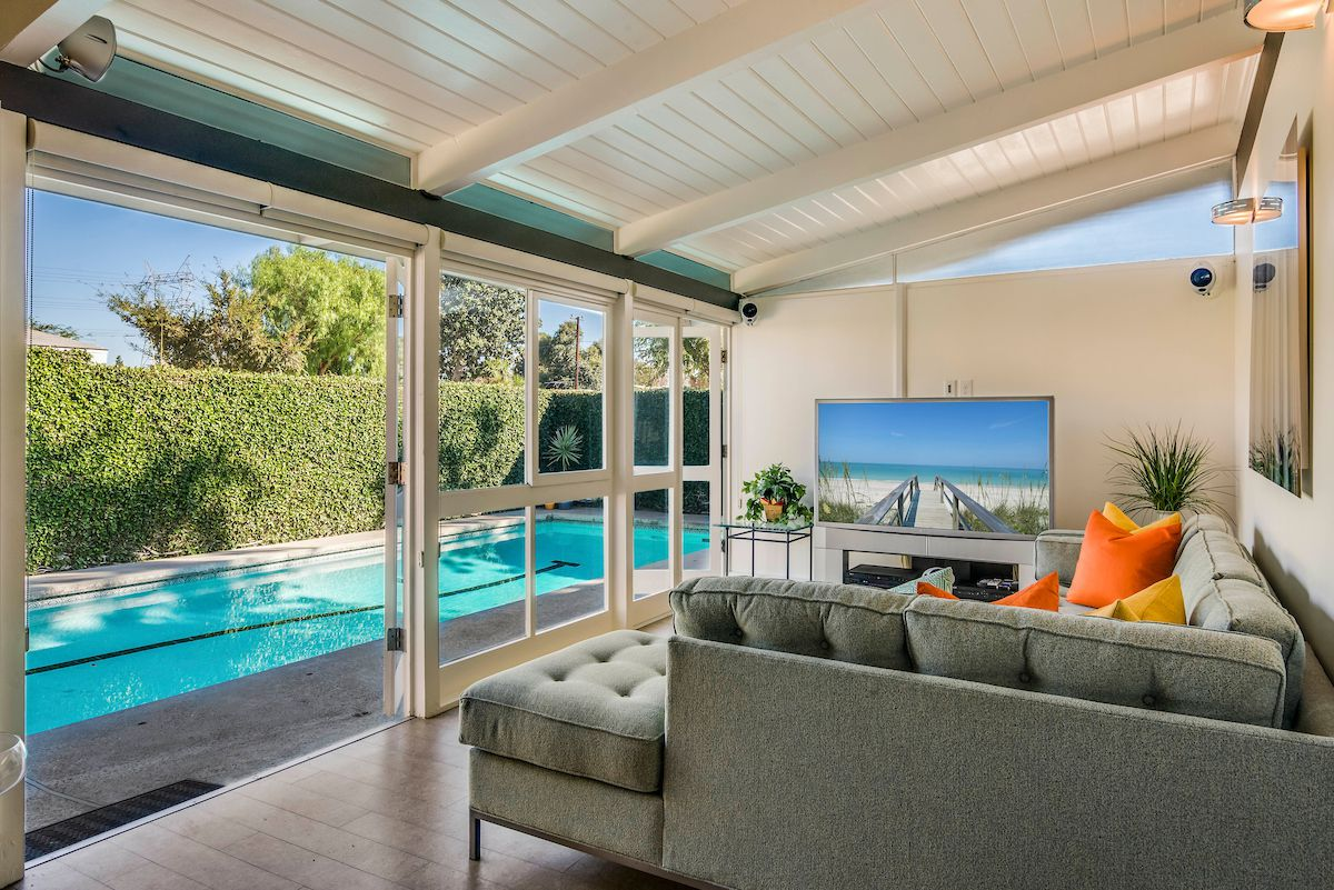 Family room by pool