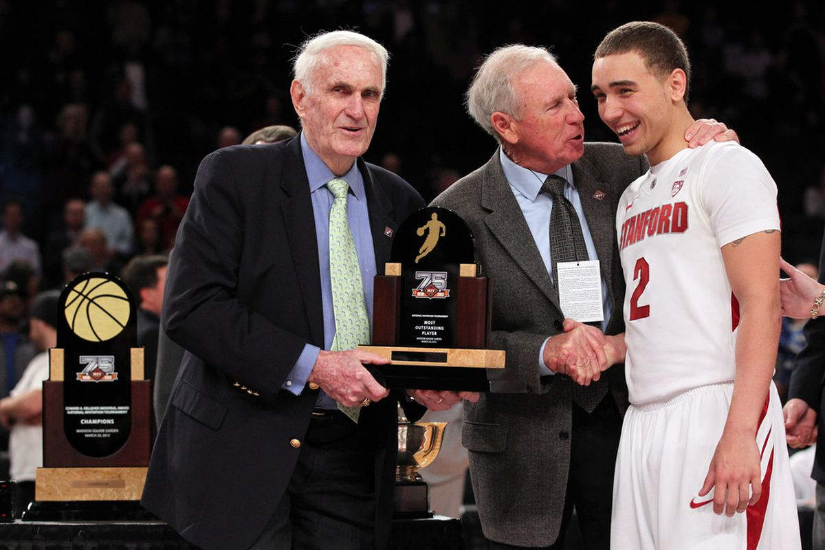 Most Outstanding Player <strong>Aaron Bright</strong> (Stanford) being presented with NIT championship trophy by Tournament Committee Chairman, C.M. Newton.