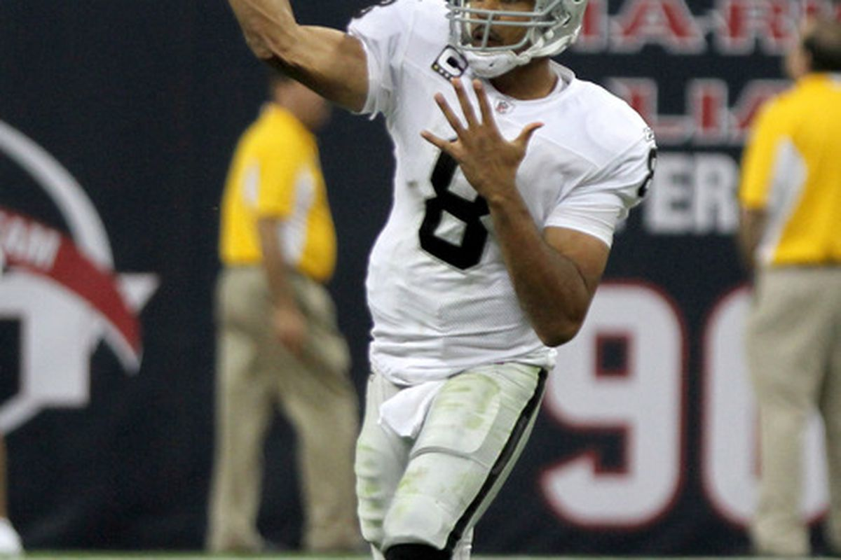 HOUSTON, TX - OCTOBER 09:  Quarterback Jason Campbell #8 of the Oakland Raiders passes against the Houston Texans on October 9, 2011 at Reliant Stadium in Houston, Texas. Raiders won 25 to 20.(Photo by Thomas B. Shea/Getty Images)