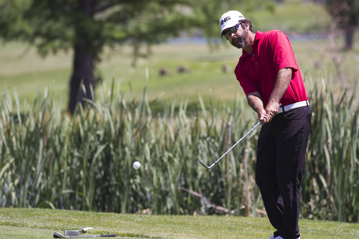 FILE: Joe Summerhays pops the ball out of the grass on the third day of the 78th Provo Open at East Bay Golf Course in Provo Saturday, June 10, 2017.